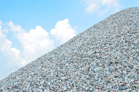 Hill of coarse aggregate with the blue sky. rock for construction