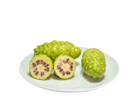 Noni Indian Mulberry fruit on white dish. white background Stock Photo