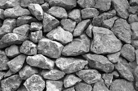 Large and small stones as stone wallpaper