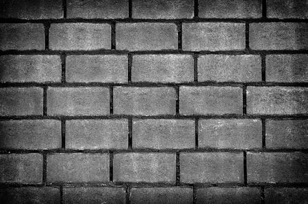 Grunge Wall of Cement Brick Surface, Dark background at home building. Фото со стока