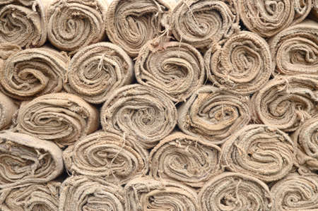 Narural jute burlap roll pile for background