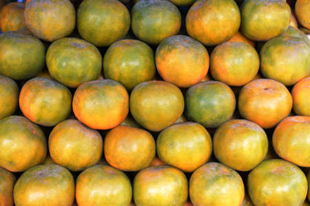 Many fresh Tangerine oranges stacked in the local market