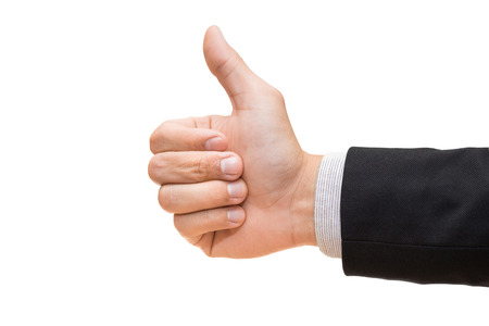 thumb's up: Businessman hand giving thumbs up isolated on white background Stock Photo
