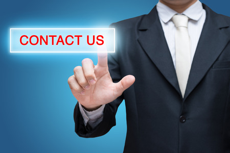 Businessman pressing contact us button isolated on over blue background