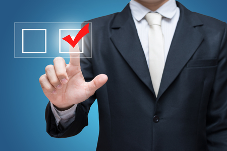 make a choice: Businessman touch checking mark checklist marker Isolated on blue background