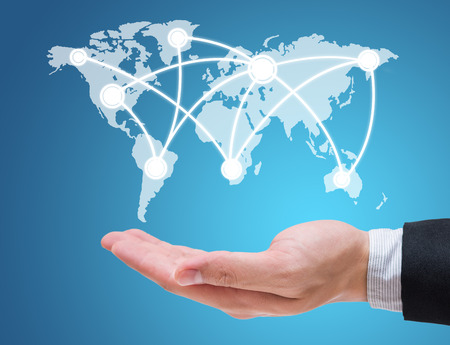 background information: Businessman hand holding globe map isolated on blue background Stock Photo