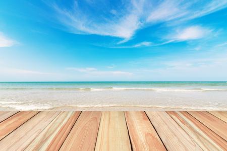blue summer sky: Wood floor on beach and blue sky background