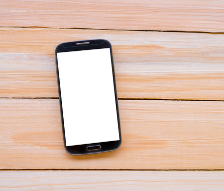 clipping  messaging: Smart phone on wooden desk