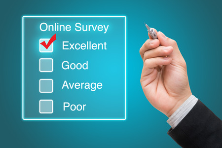 Hand clicking online survey on virtual screen Stock Photo