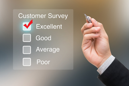 Hand clicking customer survey on virtual screen