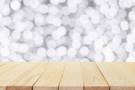 christmas bubbles: Wood table on white bokeh background Stock Photo