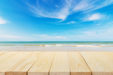 table top: Wood floor on beach and blue sky background