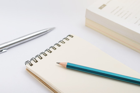 Blank notebook with pencil on white background