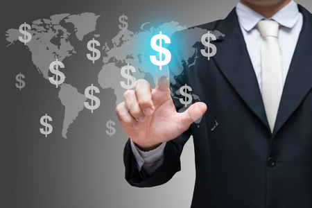 hand touch: Businessman hand touch financial symbols on gray background Stock Photo
