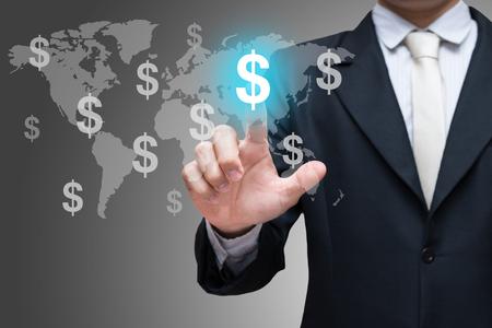 Businessman hand touch financial symbols on gray background Zdjęcie Seryjne