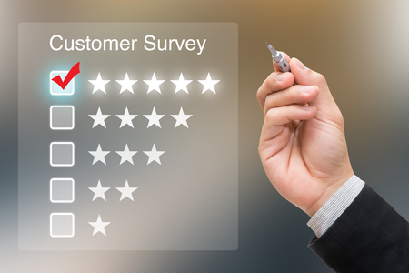 Hand clicking customer survey on virtual screen
