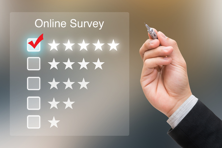 Hand clicking online survey on virtual screen Stock fotó