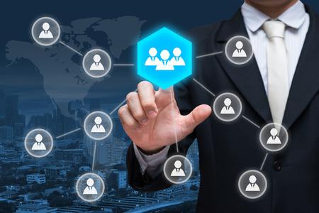 Businessman hand touch businessman icon network - HR,HRM,MLM, teamwork & leadership concept 版權商用圖片