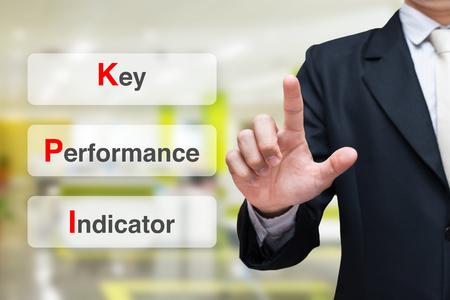 Businessman writing key performance indicator ( KPI )