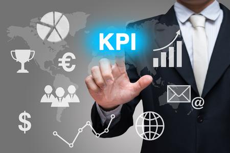 Symboles d'affaires main touche KPI sur fond gris Banque d'images - 71232287