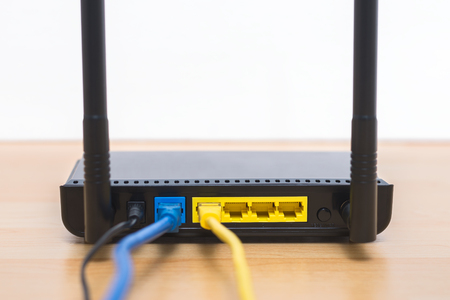 Wireless modem router with cable connecting Stock fotó