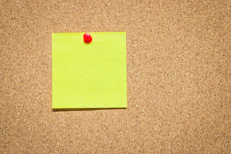 Yellow reminder sticky note on cork board, empty space for text Stock fotó