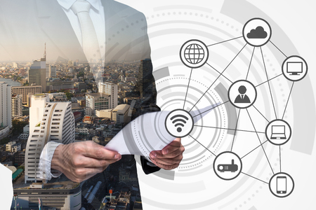 Double exposure of business person and wireless communication network 版權商用圖片