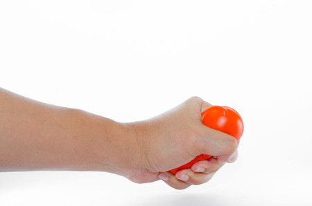 Hand squeeze  orange ball is exercise, treatment of office syndrom photo