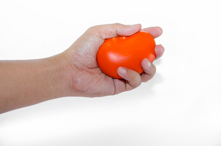 How to Squeeze a ball for hand therapy step 1 photo