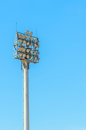 Larger Stadium light tower in day time photo