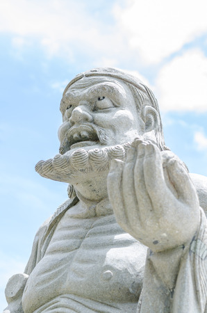 Chinese god sculpture with white background photo