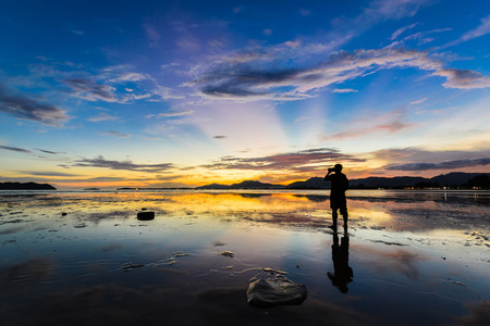 Photographer take a photo on colorful sunset photo