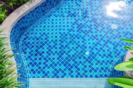 pools: Blue mosaic swimming pool floors Stock Photo