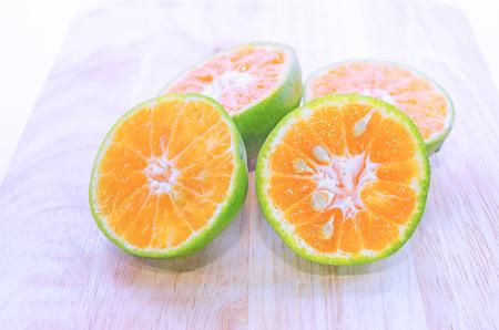 green been: Green Orange fruit has been slit
