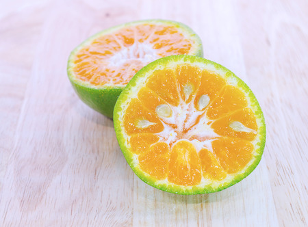 slit: Green Orange fruit has been slit