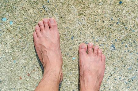 barefoot on concrete floor photo