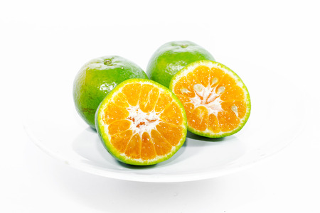 green been: Green Orange fruit has been slit