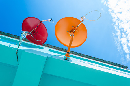broadcasting: Television Dish with red and orange color for local paid broadcasting Stock Photo