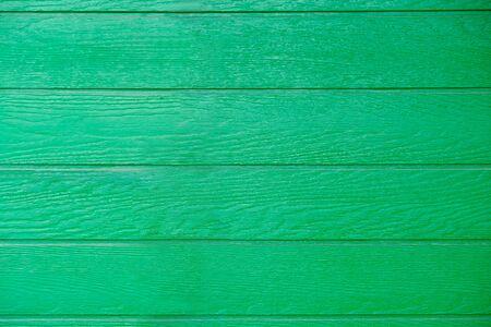 House wall is made imitation of natural green wood