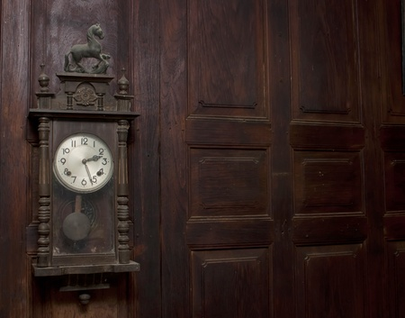 winder: Antique clock winder and old wood.