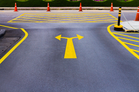 bidirectional: A bi-directional arrow symbol on asphalt road