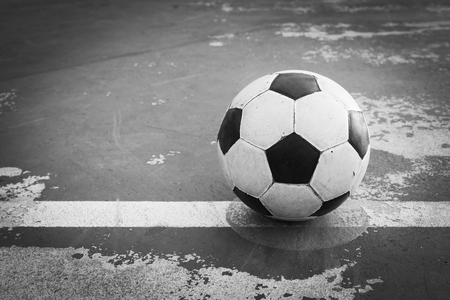 kick off: black and white old ball at kick off point