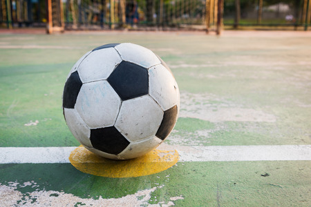 kick off: old ball at kick off point Stock Photo