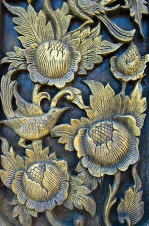 folwer carved gold paint on church door photo
