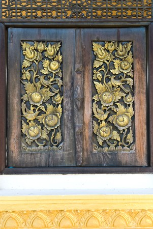 Buddha carved gold paint on church door Stock Photo - 7774031