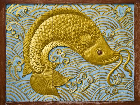fish carve gold paint in temple wall Stock Photo - 8210525