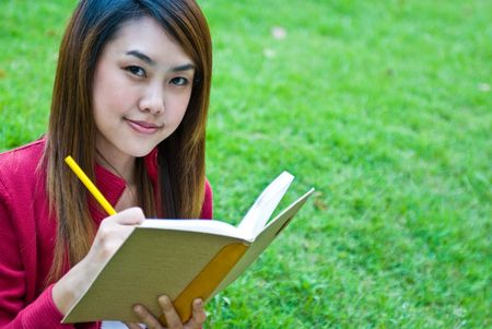 Portrait of the young beautiful with the book photo