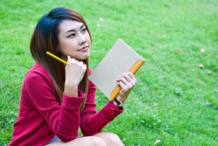 Portrait of the young beautiful with the book Stock Photo - 8210590