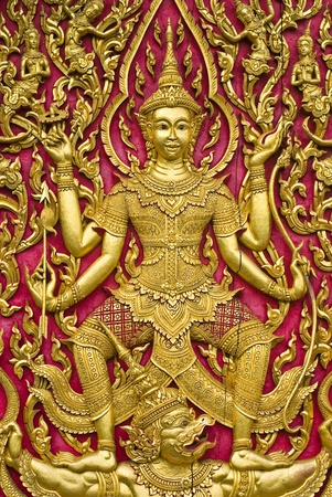 Buddha carved gold paint on church door Stock Photo - 8340006