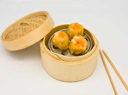 Chinese streamed spawn dimsum in bamboo containers traditional cuisine photo
